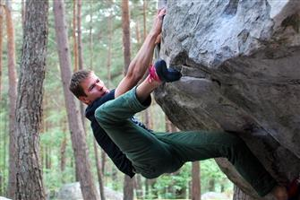 climber doing heel hook outdoors
