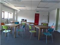 Group room with tables and chairs - projector available to hire