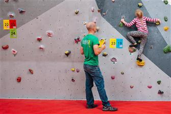 instructor instructing a youth climber